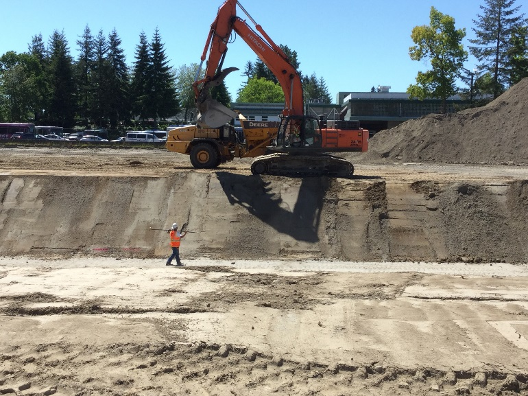 Contractor working side slopes of infiltration system